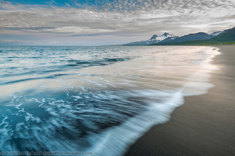 Landscape of waves washing up along the sandy beach of Katmai National Park, Aleutian mountain range, Alaska peninsula, southwest Alaska. (Patrick J. Endres / AlaskaPhotoGraphics.com)