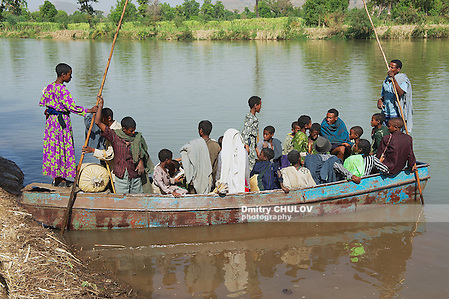 BAHIR DAR, ETHIOPIA - JANUARY 21, 2010: Unidentified passengers embark local ferry boat to cross the Blue Nile river in Bahir Dar, Ethiopia. (Dmitry Chulov)