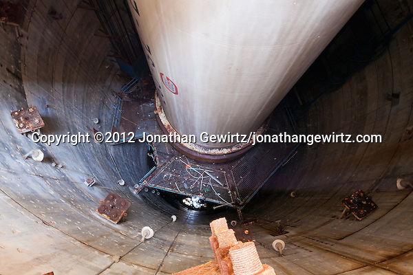 A 2012 view of the interior of the vertical test pit containing the casing of a 260-inch diameter solid-fueled rocket motor, one of the largest solid-fuel rocket motors ever made. The Aerojet company built the development and test facility in the 1960s in the Florida Everglades near Miami, in an unsuccessful bid to get NASA to adopt its rocket motors for use in the US space program. The facility has been abandoned for many years and sits on land controlled by the South Florida Water Management District. (© 2012 Jonathan Gewirtz / jonathan@gewirtz.net)