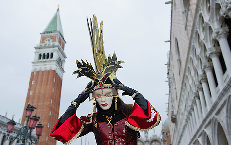 VENICE, ITALY - FEBRUARY 20: A woman wearing Carnival costume and mask poses in St Mark Square on February 20, 2011 in Venice, Italy. The Venice Carnival, one ofthe largest and most important in Italy, attracts thousands of people from around the world each year. The theme for this year's carnival is Ottocento amd Sissi, a nineteenth century evocation, andwill runfrom February 19 till March 8. (Marco Secchi)