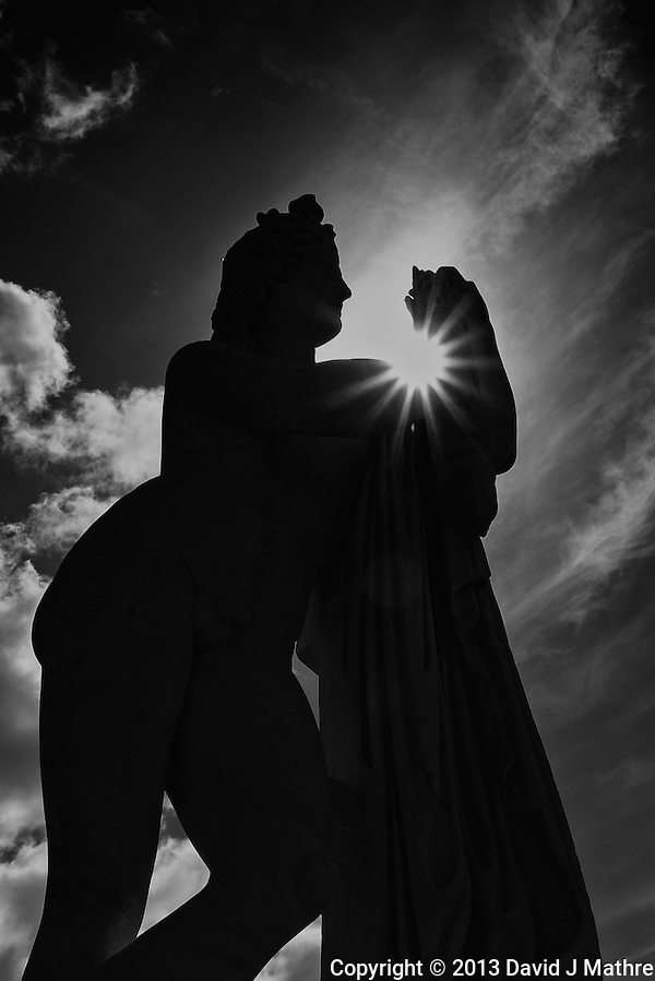 Statue and Sunburst in the Palace of Versailles Gardens. Image taken with a Leica X2 camera (ISO 100, 24 mm, f/16, 1/320 sec). NIK Silver Efex Pro. (© 2013 David J Mathre)