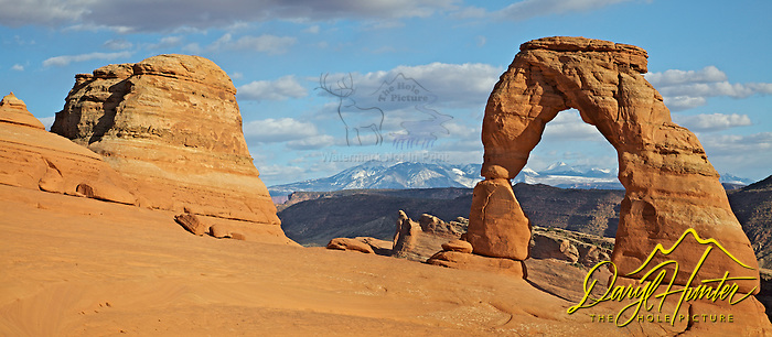"Delicate Arch, La Sal Mountains, Arches National Park, Moab, Utah (Daryl Hunter's ""The Hole Picture"" � Daryl L. Hunter has been photographing the Yellowstone Region since 1987, when he packed up his view camera, Pentex 6X7, and his 35mm�s and headed to Jackson Hole Wyoming. Besides selling photography Daryl also publ)"