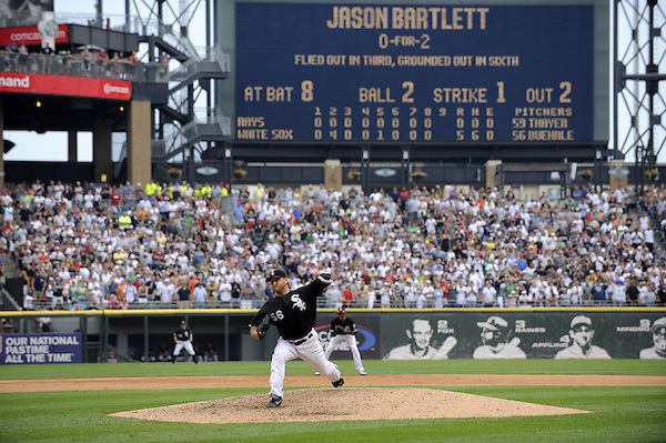 CHICAGO - JULY 23:  Mark Buehrle #56 of the Chicago White Sox throws the final pitch of the game to Jason Bartlett to record the 18th perfect game in major league history against the Tampa Bay Rays on June 23, 2009 at U.S. Cellular Field in Chicago, Illinois.  The White Sox defeated the Rays 5-0. (Photo by Ron Vesely) (Ron Vesely)