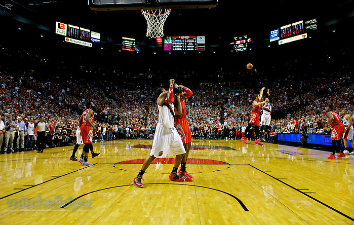 May 2, 2014; Portland, OR, USA; Portland Trail Blazers guard Damian Lillard (0) shoots the game winning three pointer over Houston Rockets forward Chandler Parsons (25) in game six of the first round of the 2014 NBA Playoffs at the Moda Center. Mandatory Credit: Craig Mitchelldyer-USA TODAY Sports (Craig Mitchelldyer/Craig Mitchelldyer-USA TODAY Sports)