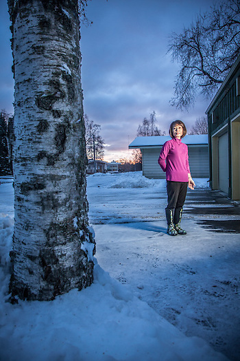 "Rental owner Christine Yi in front of her home in Bootler's Cove in Anchorage.  ""If I could be anything, I would like to be a police officer"".  yich83@gmail.com (© Clark James Mishler)"