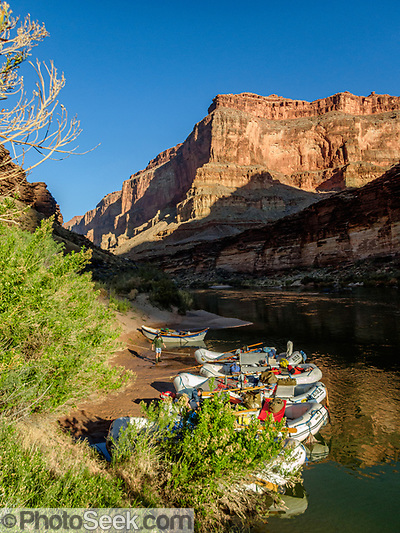 Sunrise on rafts moored at 120-Mile Camp, Grand Canyon National Park, Arizona, USA. Day 9 of 16 days rafting 226 miles down the Colorado River in Grand Canyon National Park, Arizona, USA. For this photo's licensing options, please inquire at PhotoSeek.com. (© Tom Dempsey / PhotoSeek.com)