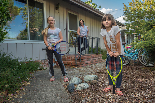Esthetician Jen Freutel with her daughters, Skylar (11) and Hayden (7) in front of their home in Calistoga (Clark James Mishler)