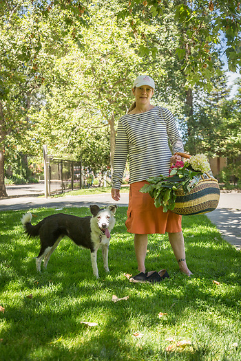 Wine maker and 14 year resident of Calistoga Julie Dumoland and her border collie, Tipper, return  from the Calistoga Saturday Market. (Clark James Mishler)