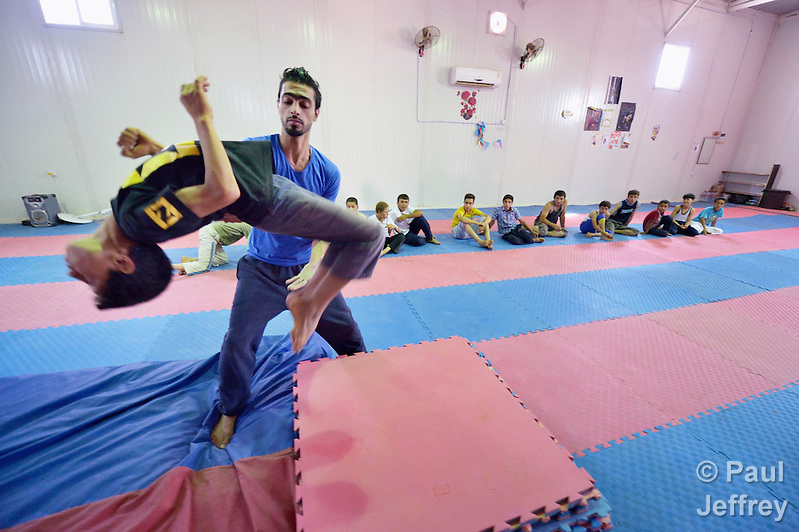 Boys learn gymnastics and circus skills as part of a psycho-social program run by Finn Church Aid in the Zaatari refugee camp near Mafraq, Jordan. Established in 2012 as Syrian refugees poured across the border, the camp held more than 80,000 refugees by early 2015, and was rapidly evolving into a permanent settlement. Finn Church Aid is a member of the ACT Alliance, which provides a variety of services to refugees living in the camp. (Paul Jeffrey)