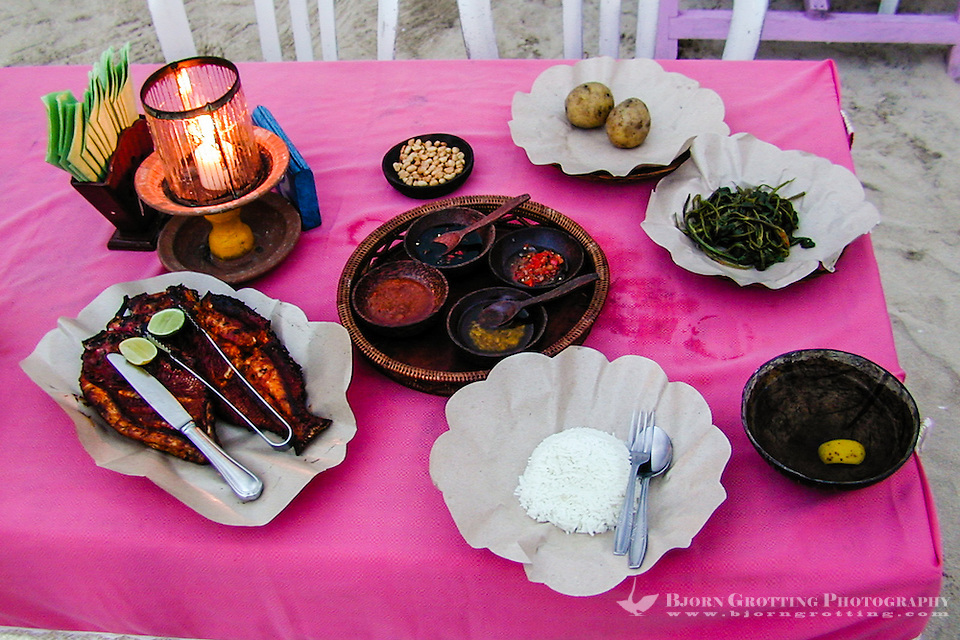 Bali, Badung, Jimbaran. Restaurant at the sea. A delicious, simple and cheap meal; grilled red snapper. It comes with salad, potatoes, various sauces, rice and vegetables (and Bintang beer). (Photo Bjorn Grotting)
