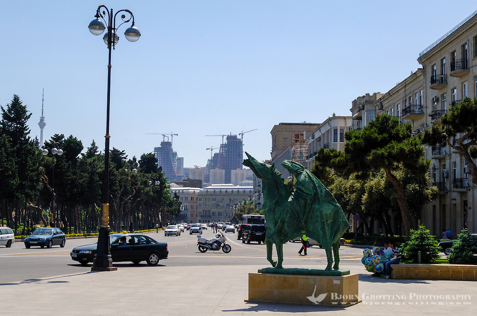 Azerbaijan, Baku. A statue in front of the Azerbaijan State Carpet Museum. Flame Towers, a residential complex under construction in the background. (Photo Bjorn Grotting)