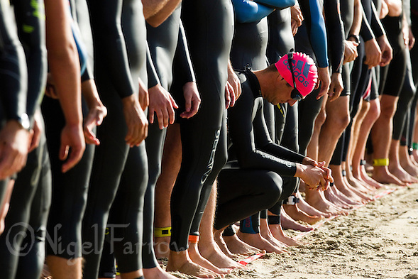18 SEP 2011 - LA BAULE, FRA - A competitor waits for the start of the Triathlon Decouverte (sprint distance) at the 24th Triathlon Audencia in La Baule, France (PHOTO (C) NIGEL FARROW) (NIGEL FARROW/(C) 2011 NIGEL FARROW)