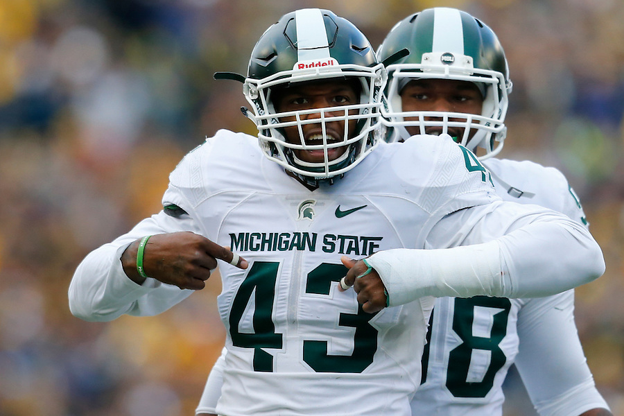 Oct 17, 2015; Ann Arbor, MI, USA; Michigan State Spartans linebacker Ed Davis (43) celebrates his sack in the first half against the Michigan Wolverines at Michigan Stadium. Mandatory Credit: Rick Osentoski-USA TODAY Sports (Rick Osentoski/Rick Osentoski-USA TODAY Sports)