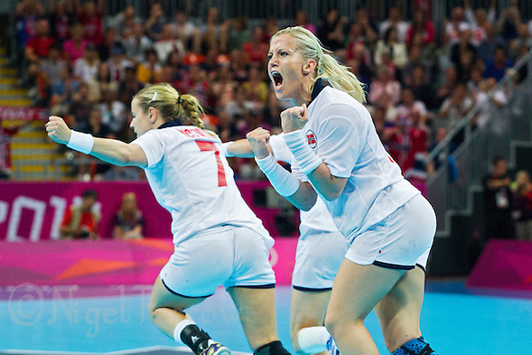 11 AUG 2012 - LONDON, GBR - Heidi Løke (NOR) (right) of Norway celebrates a goal during the women's London 2012 Olympic Games handball final against Montenegro at the Basketball Arena in the Olympic Park, in Stratford, London, Great Britain .(PHOTO (C) 2012 NIGEL FARROW) (NIGEL FARROW/(C) 2012 NIGEL FARROW)