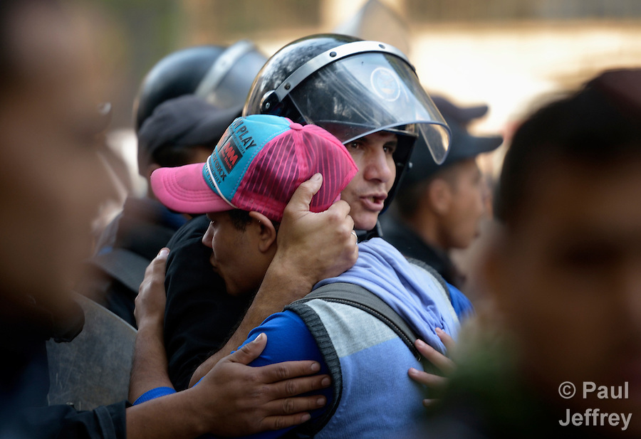 A police officer and a demonstrator embrace during a rare moment of dialogue during November 27, 2012, protests in Cairo's Tahrir Square. The protestors were upset by Egyptian President Mohammed Mursi's November 22nd decision to assume sweeping new powers. Moments after this photo was taken, the police, under a barrage of rocks from demonstrators, fired tear gas and gave chase to the demonstrators.
