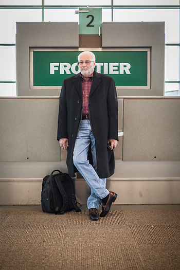 "Tulsa roof consultant Leon Dazey awaits his flight at the Oklahoma City International Airport  ""I'm flying to Boise…my company doesn't like it much, but I am flying first-class…this flight is just too long.""  lrdazey@metlspan.com (© Clark James Mishler)"