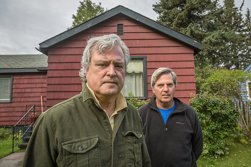 """We've always wanted to fix this place up...but it's a slow process.""  -Brothers George and David Freeman stand in front of their home in Anchorage, Alaska. (Clark James Mishler)"