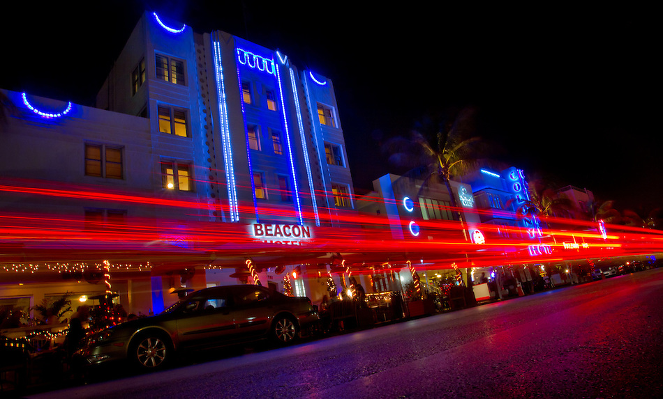 Tail lights streak as cars cruise the Art Deco district of Miami's South Beach. (Christopher Gannon)