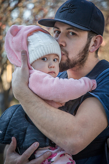 "Marcelo Martinez with his eight month old daughter, Alia, near his parent's home in Calistoga.  ""I started working for a local bank just recently...I very much like the work.  It is my dream to someday own my own business.""  martinez.m777@yahoo.com (Clark James Mishler)"