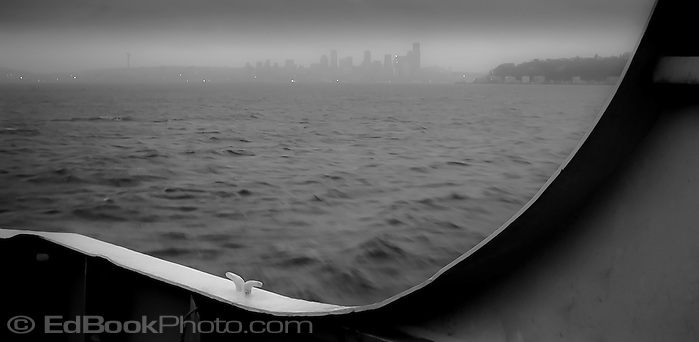 an early rainy gloomy morning trip on a ferry to Seattle across Puget Sound, Washington, USA (Ed Book)