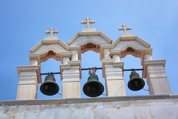 View of a white church's bells under the crosses at Mykonos in Greece (Ian C Whitworth)