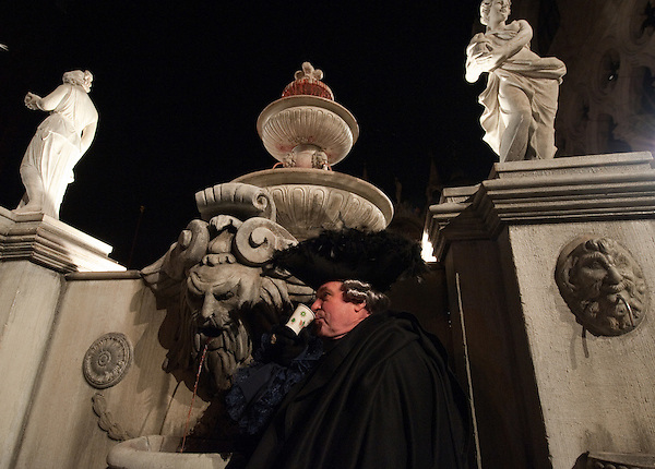 Official opening of 2012 Venice Carnival and Members of the association 'Amici del Carnevale di Venezia' wearing 18th century costumes enjoy live music and wine from the wine fountain in St Mark Square (Marco Secchi)