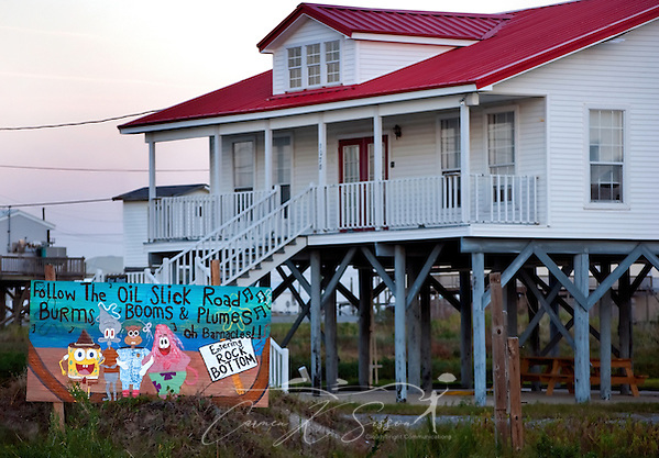 A hand-painted sign along Louisiana Highway 1 expresses Grand Isle residents' frustrations over the Deepwater Horizon BP oil spill Nov. 23, 2010. The barrier island, situated on the Gulf of Mexico at the southernmost tip of Louisiana, was heavily affected when the Deepwater Horizon oil rig exploded April 20, 2010, killing 11 workers and causing the largest offshore oil spill in United States history. (Photo by Carmen K. Sisson/Cloudybright) (Carmen K. Sisson/Cloudybright)