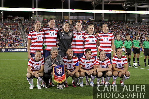 September 19, 2012 Commerce City, CO.  USA head coach Pia Sundhage poses with her team one last time prior to the Soccer Match between the USA Women's National Team and the Women's Australian team at Dick's Sporting Goods Park in Commerce City, Colorado (Carl Auer/Cal Sport Media)