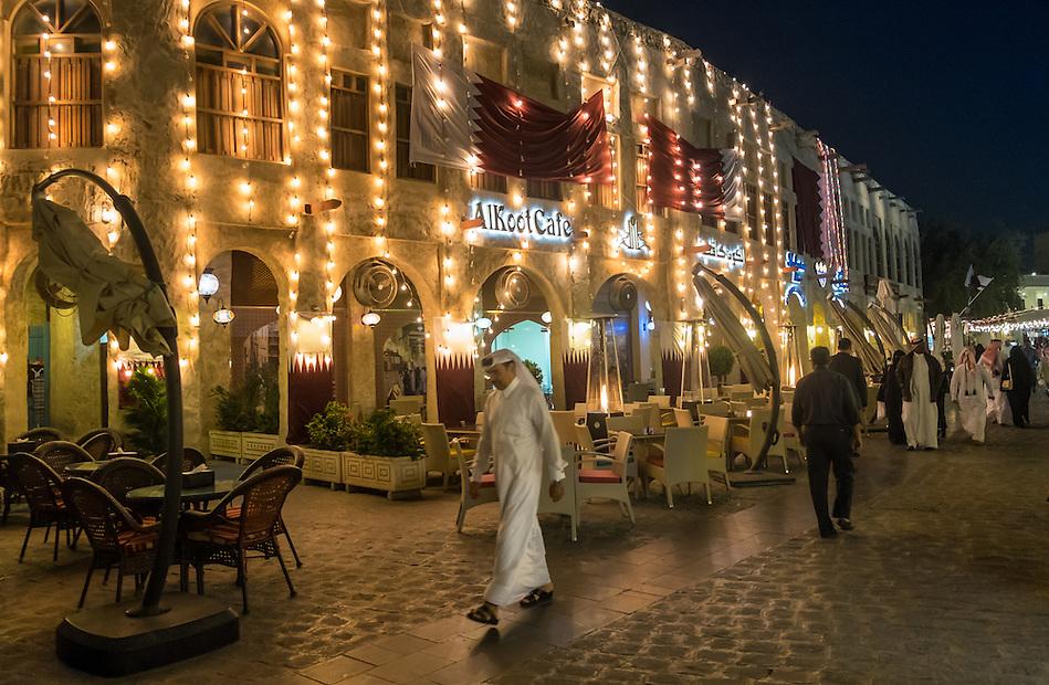 DOHA, QATAR - CIRCA DECEMBER 2013: People walking over at the Souq Waqif. This is a popular and traditional market bazaar in Doha. (Daniel Korzeniewski)