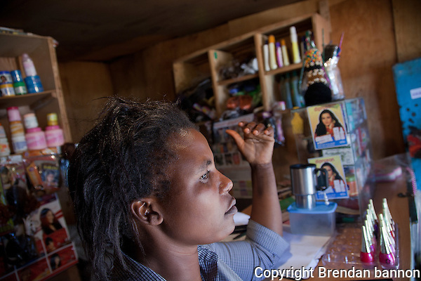 "Cynthia Achieng's Olympic Beauty Shop was destroyed following election violence in 2008, but she says ""you cannot dwell on mistakes which are not your fault"". She has since expanded her business and says she is 'optimistic' for the future despite Kenya's ""always politicking"". (brendan bannon)"