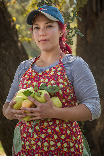 "Halie Link sells apples at the Apple Pantry Farm in Camino, CA during the Apple Hill fall apple festival. ""I like the way everyone in this community has everyone else's back...its a great place to live."" (Clark James Mishler)"