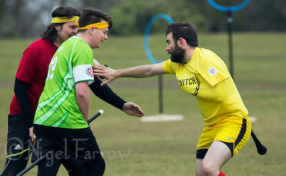 08 MAR 2015 - NOTTINGHAM, GBR - Snitch runner Jordan Niblock (right) attempts to evade the seekers from Keele Squirrels and Bristol Brizzlepuffs during their 2015 British Quidditch Cup match at Woollaton Hall and Deer Park in Nottingham, Great Britain (PHOTO COPYRIGHT © 2015 NIGEL FARROW, ALL RIGHTS RESERVED) (NIGEL FARROW/COPYRIGHT © 2015 NIGEL FARROW : www.nigelfarrow.com)