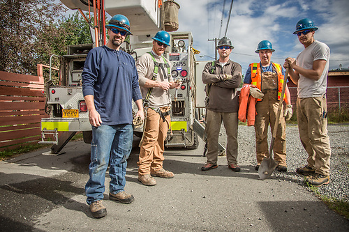 ML&P Heavy Crew members: Eric, Daniel, Shelfon, Butch and Brian,  prepare for maintenance work in an alley in Anchorage's South Addition neighborhood.  superlineman@gmail.com (© Clark James Mishler)