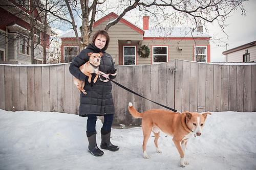Neighbor Melissa Portera and her dog Oliver. (© Clark James Mishler)