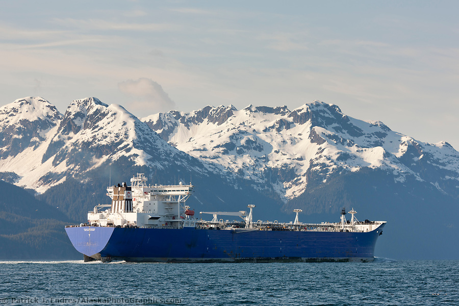 The polar enterprise oil tanker travels north into the valdez arm, Chugach mountains range borders the channel, prince william sound, Alaska. (Patrick J. Endres / AlaskaPhotoGraphics.com)