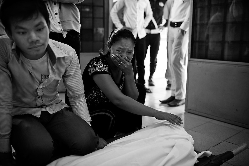 A new family member arrives to find her loved one has been lost in the stampede tragedy in Phnom Penh Cambodia on November 22nd, 2010. Nearly 400 people lost their lives when thousands tried to flee Diamond Island over a bridge. The cause of the panic has still not been confirmed. (Quinn Ryan Mattingly)