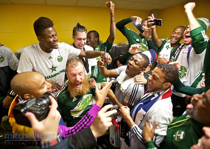 Dec 6, 2015; Columbus, OH, USA; Portland Timbers forward Fanendo Adi gives Nat Borchers' beard a trim after winning the 2015 MLS Cup at MAPFRE Stadium. Photo: Craig Mitchelldyer-Portland Timbers (Craig Mitchelldyer)