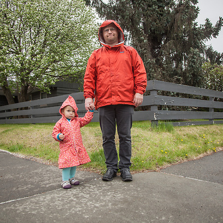"Bjorn Carlson and his dauther Feyja at the corner of 13th and G Street, Anchorage.  ""I teach kids at McLaughlin Youth Center.  I love it there.""  bjorncarlsonak@gmail.com (© Clark James Mishler)"