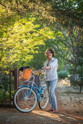 """I ride my bike to work...when I'm not running late...which is to say, not often enough.""  -Eden Umble on her way home on Cedar Street in Calistoga (Clark James Mishler)"