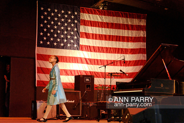 """""""East Meadow, New York, U.S. October 15, 2008. SHEIMYRAH MIGHTY, a 10-year-old Haitian American singer, walks across stage of Harry Chapin Theater after singing God Bless America at start of Obama Rally at Eisenhower Park. (© 2008 Ann Parry/AnnParry.com)"""