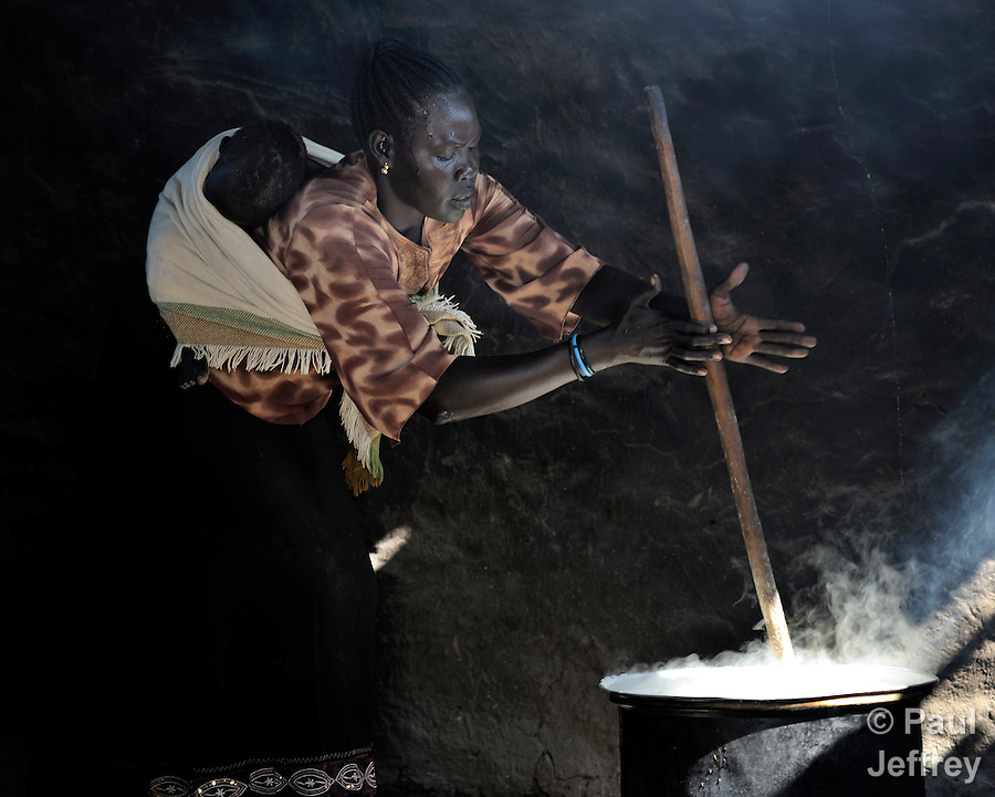 A woman cooking lunch for students in a school in Yei, Southern Sudan, sponsored by the United Methodist Church.