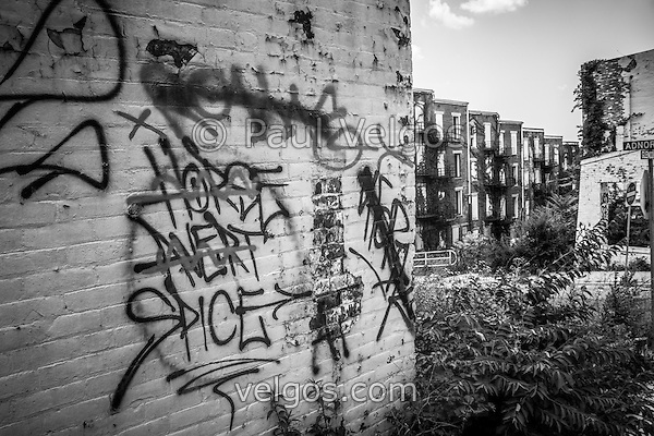 Cincinnati abandoned buildings graffiti at the Glencoe-Auburn Place Complex. The Glencoe-Auburn Hotel and Glencoe-Auburn Place Row Houses were built in the late 1800's and are listed on the U.S. National Register of Historic Places. The complex is currently abandoned and in extremely poor condition. Photo is high resolution black and white. (Paul Velgos)