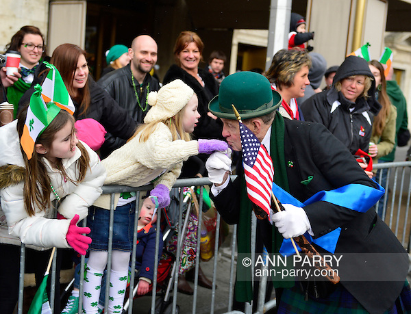 March 16, 2013 - New York, NY, U.S. - 'Leprechaun' NOEL RYAN, an alumnus of Quinnipiac College, kisses hand of young girl in crowd at the 252nd annual NYC St. Patrick's Day Parade. Thousands of marchers show their Irish pride, as they march up Fifth Avenue, and over a million people, often in green and orange, watch and celebrate. (Ann Parry/Ann Parry, ann-parry.com)