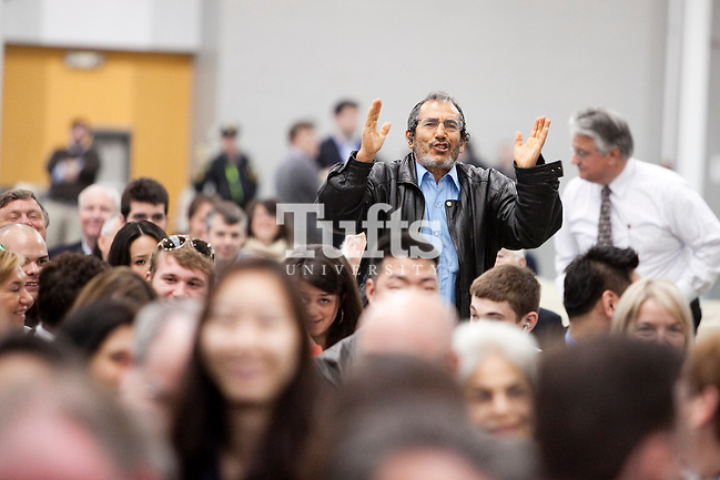 05/22/2011- Medford, Mass. - A relative of a graduate sings and dances in his seat during commencement for the Tufts University School of Medicine on May 22, 2011. (Kelvin Ma/Tufts University) (Kelvin Ma/Tufts University)