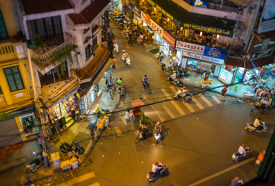 HANOI, VIETNAM - CIRCA SEPTEMBER 2014:  Busy corner street in the Hanoi Old Quarter at night in Vietnam. (Daniel Korzeniewski)