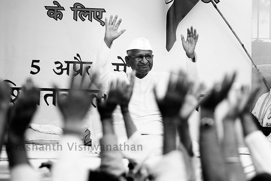 Social activist Anna Hazare reacts to his supporters shouting slogans in New Delhi, India, on Thursday, April 7, 2011. Hazare has vowed to fast to the death to rid India of the corruption he says is its biggest curse. Photographer: Prashanth Vishwanathan (Prashanth Vishwanathan)