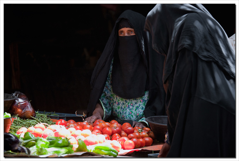 Veiled Berber women at the market in Rissani, Morocco. (Rosa Frei)