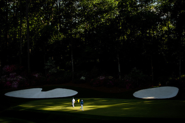 Kevin Kisner leaves the green as his caddie replaces the flagstick  at the 13th during the second round of the 2016 Masters tournament.Golf: 2016 Masters Round 2 Friday Augusta National/Augusta, GA,USA 04/08/2016 SI-14 TK2 Credit: Darren Carroll (Darren Carroll/Sports Illustrated)
