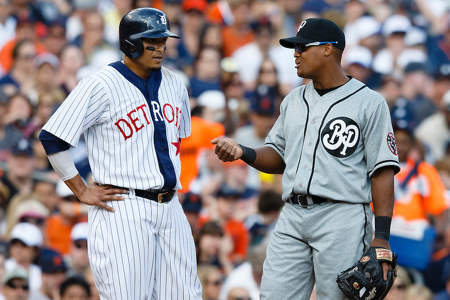 May 24, 2014; Detroit, MI, USA; Detroit Tigers designated hitter Victor Martinez (41) talks to Texas Rangers third baseman Adrian Beltre (29) during the sixth inning at Comerica Park. Mandatory Credit: Rick Osentoski-USA TODAY Sports (Rick Osentoski/Rick Osentoski-USA TODAY Sports)