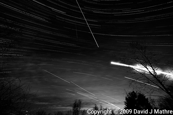 Star, Moon, and Jet Trails + Clouds. Backyard Night Sky Over New Jersey Looking South. Composite of 129 images taken with a Nikon D3 camera and 14-24 mm f/2.8 lens (ISO 200, 15 mm, f/2.8, 25 sec) (David J Mathre)
